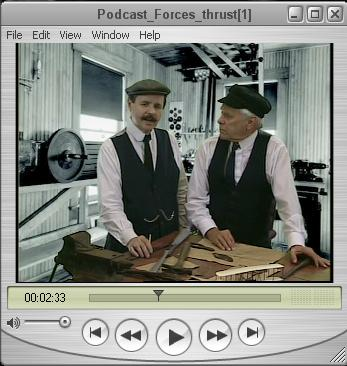 Photo of Wilbur and Orville Wright talking in their shop.